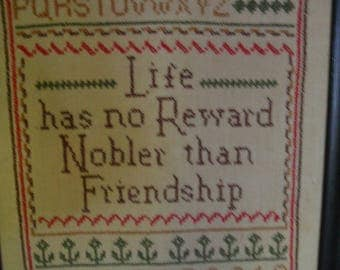 Vintage cross stitch sampler with friendship verse