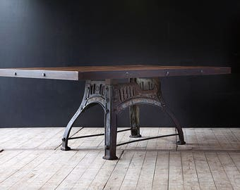 Industrial dining table with original cast iron base