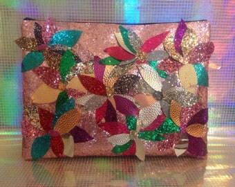 Glitter floral embellished clutch bag