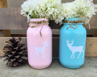 Buck or doe mason jar centerpieces. Buck and doe gender reveal mason jars. Gender reveal party decor. Blue and pink mason jars. Baby shower