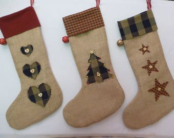 Rustic burlap/homespun Christmas stockings. Fully lined, with appliquéd hearts, stars and Christmas trees. Finished with buttons and bells.