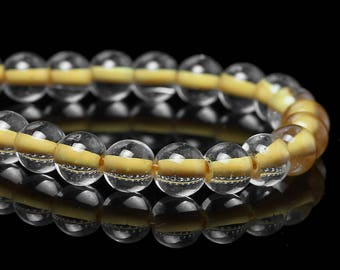 65 round beads of yellow and clear glass 6mm / round beads