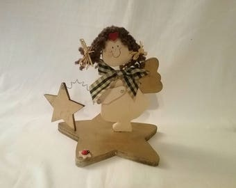 Wooden Angel with star-shaped pedestal