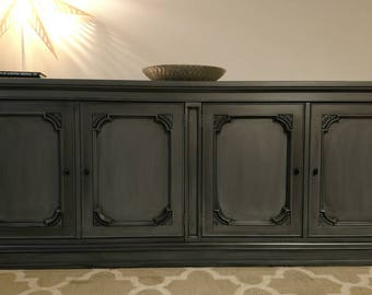 Solid wood vintage large media console located in Chicago!