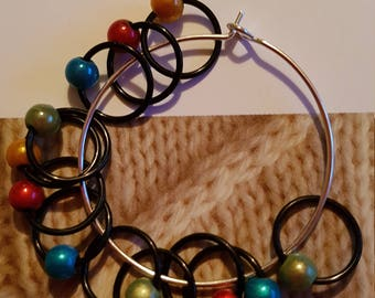 12 medium sized snag free ring style knitting stitch markers  . Brights