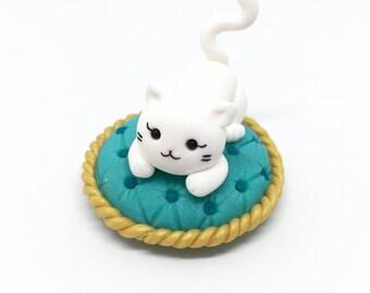 Fancy kitty cat on fluffy pillow