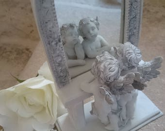 An Angel passes... Duo of cherubs in their mirror + empty pockets cherubs