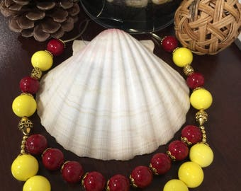 Double layered Necklace with Red and yellow and golden beads with matching earrings! Text :770 731-3422 for more pic from my Collection .