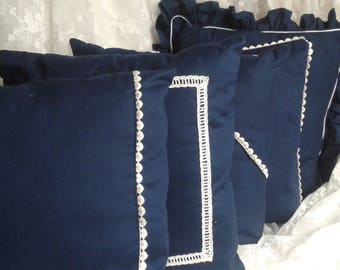 Blue pillow with lace hearts