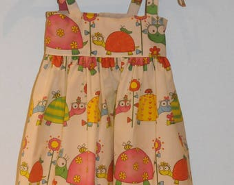 "dress with ""turtles"" theme fabric straps"