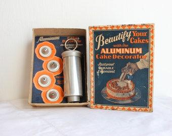 Vintage aluminum cake decorating set in original box