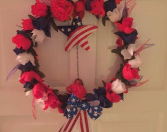 Patriotic  ring red white snd blue flowers   1 inches across  with a 6 inch opening 130