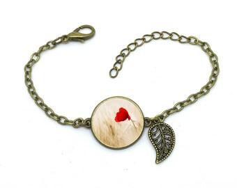 """Bracelet Coquelicot  """", fleur ,image sous cabochon résine ,monture couleur bronze,ref bN 31"""