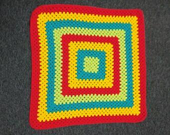 Funky granny square baby blanket.