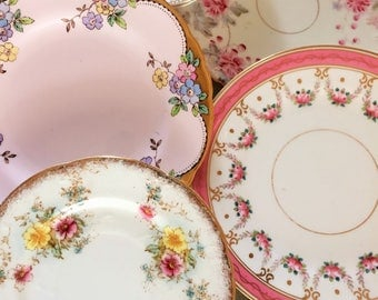 Gorgeous mismatched collection of six vintage plates in pink and blue. Old.