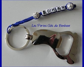 key 1 name Blue foot bottle opener with dark and white