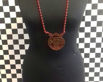 Red plastic vintage necklace.