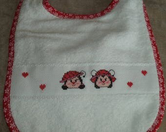 Terry bib cross-stitched with nine red ladybugs