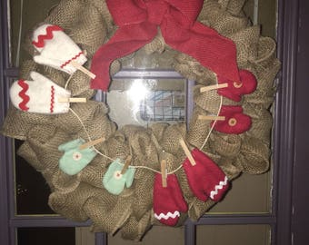 Burlap winter wreath with mittens.