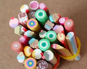 Set of 10 in polymer clay candy canes for scrapbooking, nail art, jewelry making and other creative work.