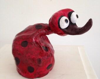 Grenadine, wacky creature in papier mache