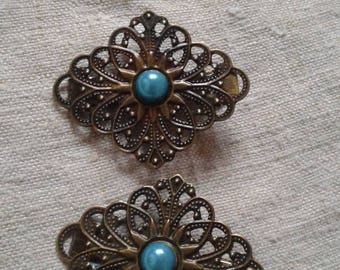 two barrettes chiseled and blue prints