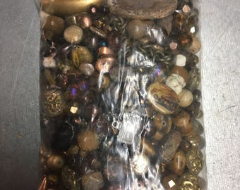 Assortment of earth-tone beads for jewelry making