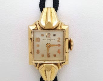 A vintage Paul Breguette 14k yellow gold ladies watch