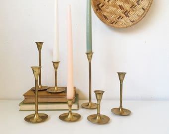 Vintage Brass Candle Holders + Set of 7 + Graduating Height + Tulip Base + MCM + Mid Century Modern Style + Hollywood Regency