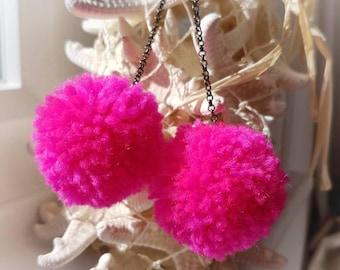 Flamingo Pink pom pom earrings.