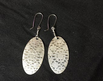 Textured sterling silver oval danglers