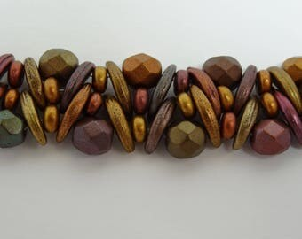 Hand beaded Czech glass bead necklace in metallic shades of orange, green, copper, pink, gold, purple and brown. Copper clasp.