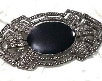 Marcasite and black enamel vintage brooch