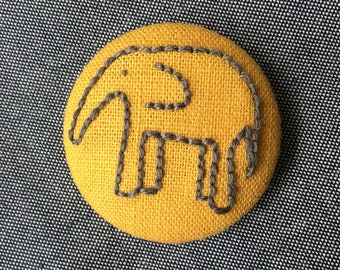 Embroidered elephant brooch, fabric-covered pin