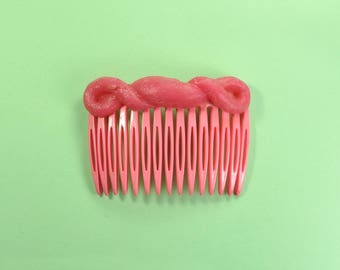 Pink comb with soft silicone decoration