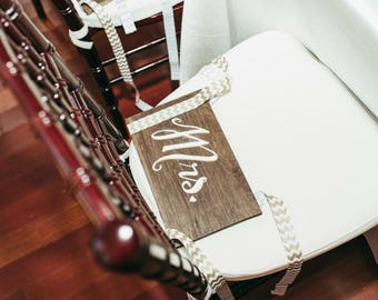 "Hand lettered ""Mr. & Mrs."" chair signs"