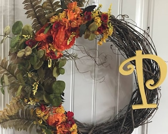 Fall Wreath in Orange, yellows and red.  Initial fall wreath