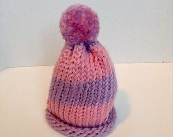 pink puffball hat