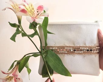 White Mirror and Embroidered Clutch