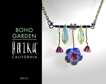 Boho Garden by HaikuCalifornia: Blue & magenta flowers and green leaves bar necklace with bronze chain.
