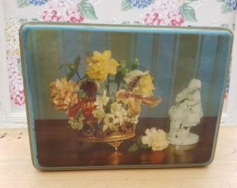 Vintage Scribbans Kemp hinged biscuit tin, still life image.