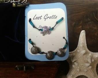 2 bracelets, turtle and sea shells