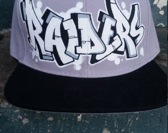 custom graffiti style raiders snapback hat