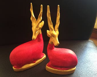 Beautiful pair of wood carved antelopes - hand painted pink and gold