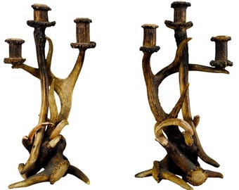 a pair of antique cabin decor antler candleholders