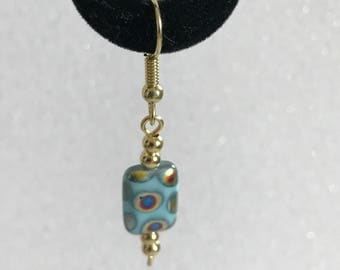 Czech turquoise color rectangle with multicolored dots set in gold