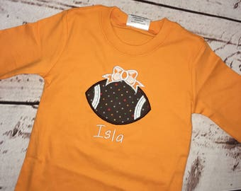 Infant onesie Girls Football with Bow applique onesie or body suit with name FREE SHIPPING