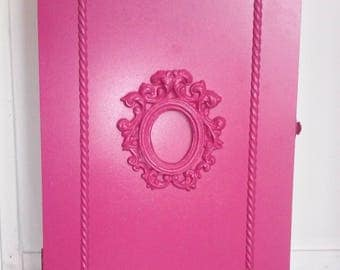 """Wall cabinet / medicine """"candy pink"""" wood with central decoration."""