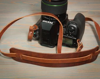 Hand made leather copper riveted camera strap with moveable shoulder pad.