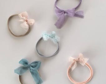 Silk chiffon bows on a nylon headband